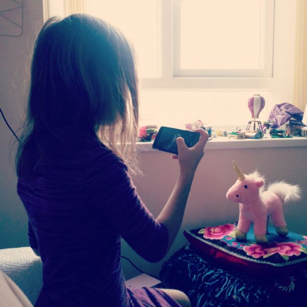 Tracy's daughter takes a picture of a pink unicorn