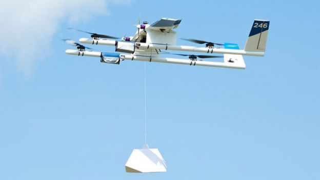 Wing drone letting down a package