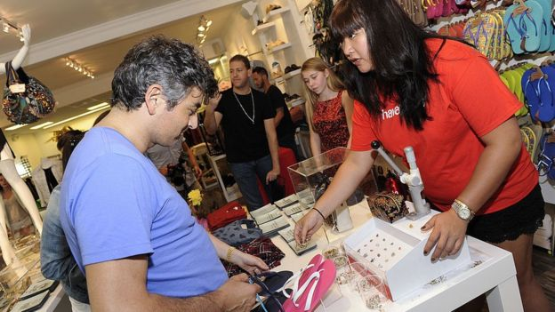 A customer picks out a pair in a store in the upmarket Hamptons area of New York