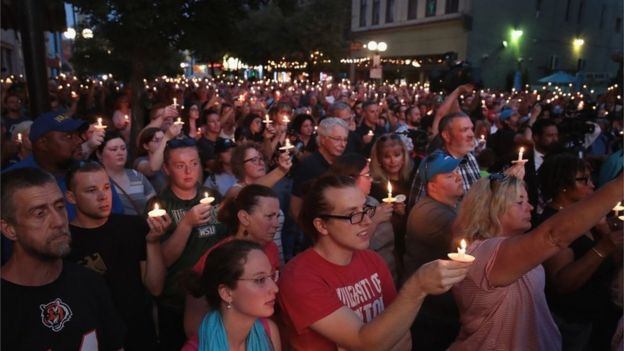 Mourners attend a memorial service in the Oregon District to recognize the victims of an early-morning mass shooting in the popular nightspot