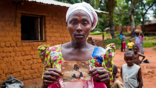 Suriya Muyombe holds a picture of her missing child