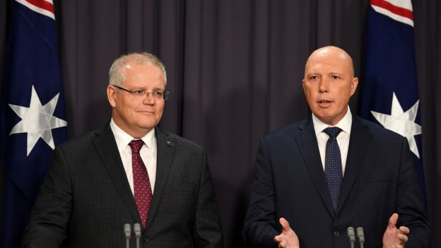 Australia's Prime Minister Scott Morrison (left) and Home Affairs Minister Peter Dutton