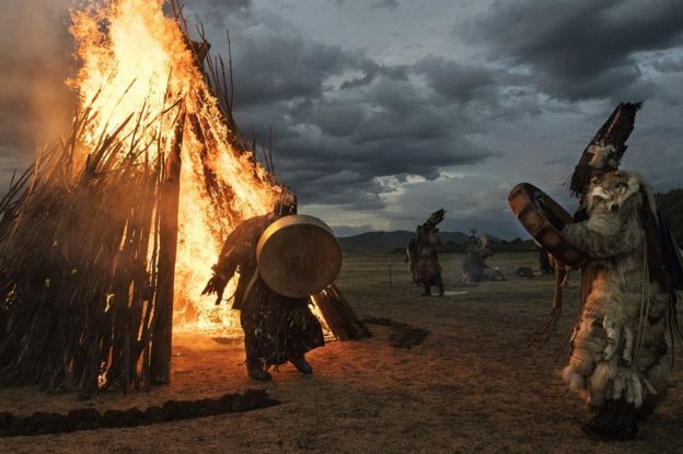 A shaman runs through fire