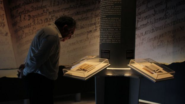 A man looks at the manuscripts at an exhibition