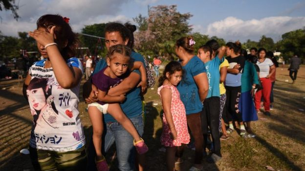 Migrants taking part in the caravan to the US queue for food in Oaxaca, Mexico on Tuesday