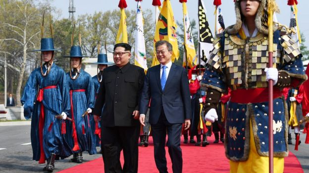 Kim Jong-un and Moon Jae-in walk through the DMZ
