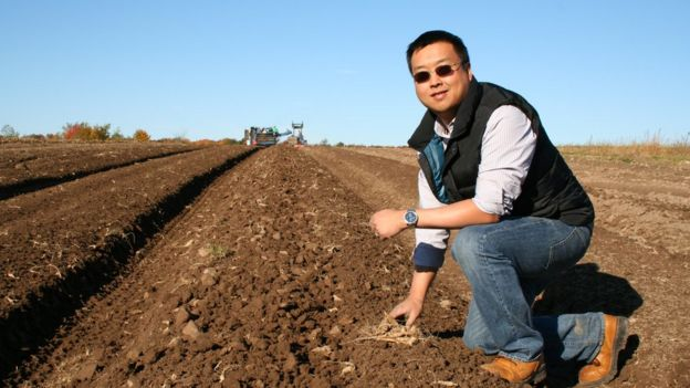 Will Hsu on a freshly harvested field in Fall of 2013.
