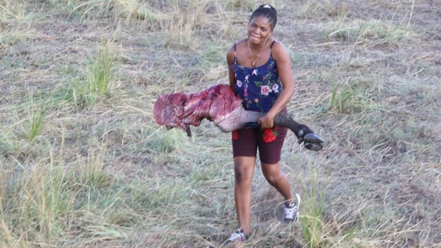 Woman holding buffalo leg