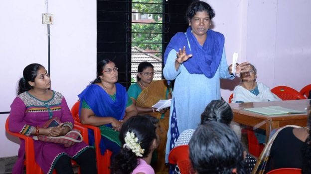Viji Palithodi addresses a group of women