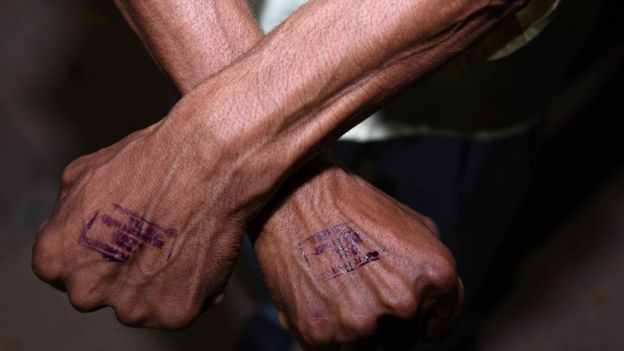 A stamp on a man's hand
