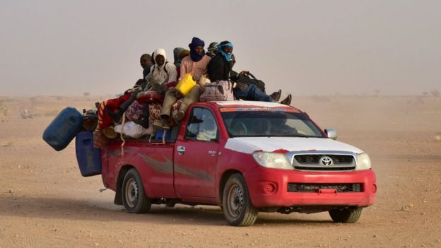 West African people coming back to Niger after fleeing Libya due to armed groups, arrive on a pick up in Agadez, northern Niger, on March 31, 2017,