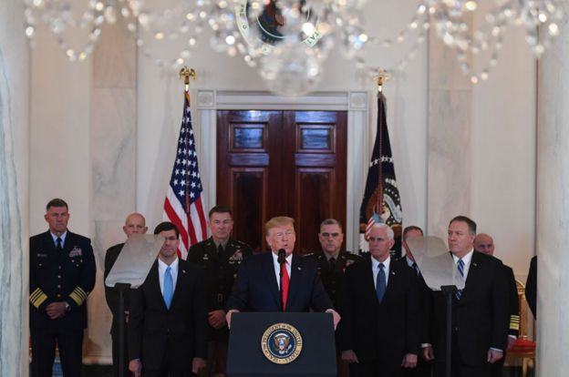 Trump surrounded by generals