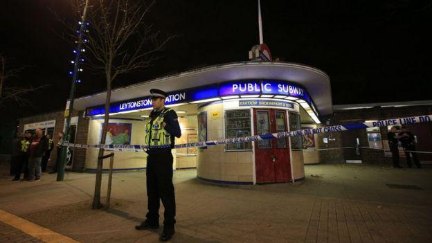 Police officer outside cordoned-off Leytonstone Tube station