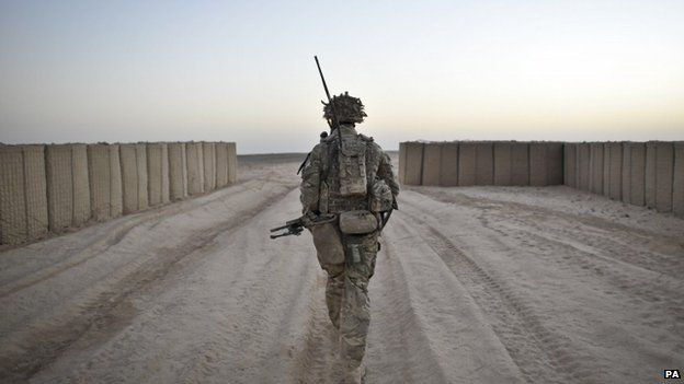 Soldier from the 1st Battalion Royal Regiment Fusiliers during a dawn foot patrol in Afghanistan