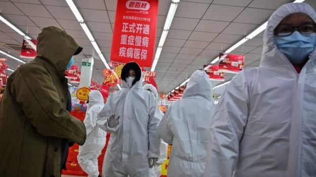 Pharmacy have been wearing protective clothes and masks serve customers in Wuhan