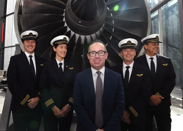 Qantas CEO Alan Joyce stands with staff