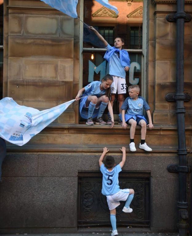 Children watching the parade
