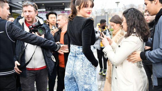 Actress Shailene Woodley wears acid wash, high-waisted jeans by Balmain