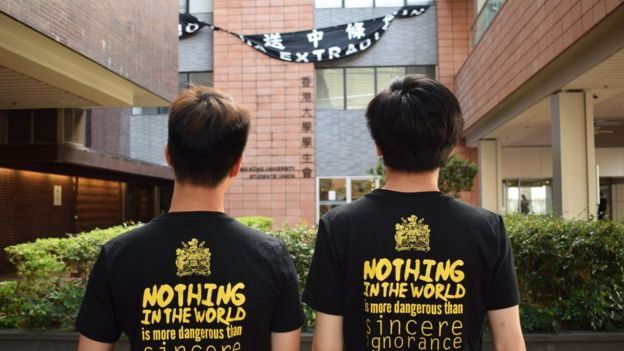 Back profile of two HKU students who took part in the protests