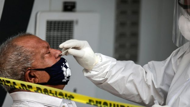 Mexican man undergoing nasal swab test