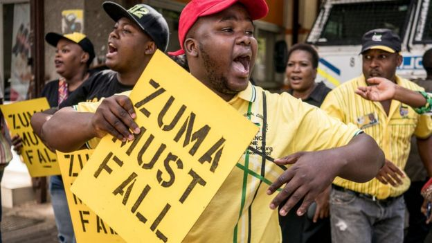 Supporters of ANC president Cyril Ramaphosa chant slogans outside party headquarter in Johannesburg, on February 5, 2018
