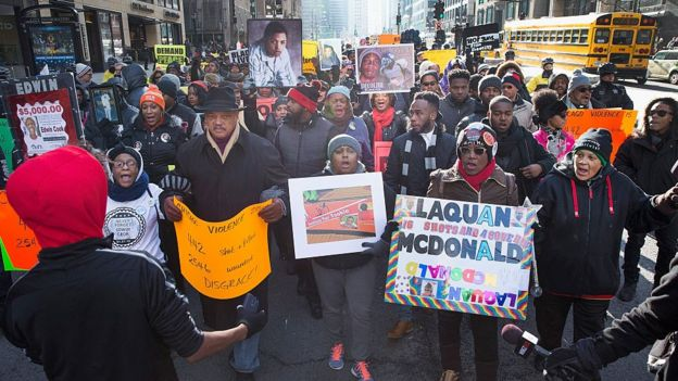 Protesters march in Chicago after the city released dashcam footage showing Laquan McDonald's death