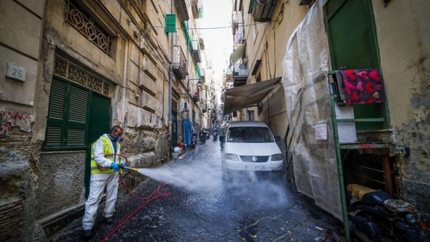 A worker disinfects the street at Quartieri Spagnoli, Naples, Italy, 18 March 2020
