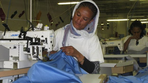 Lady working at the Dolce Vita garment factory