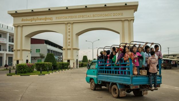 Cambodian textile workers being trucked to work