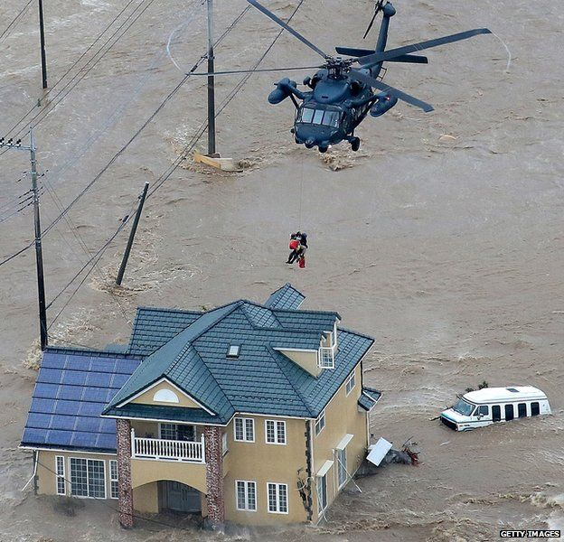 Japanese helicopter rescuing people during a flood