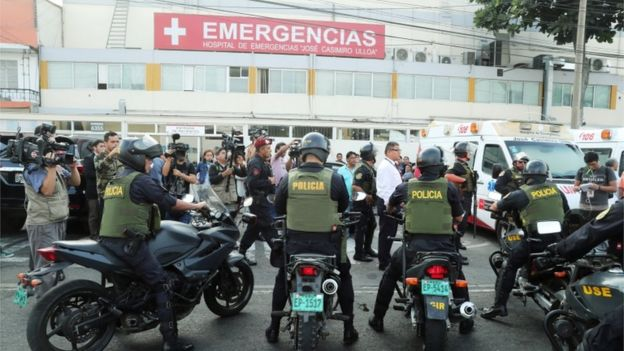 Police outside Casimiro Ulloa hospital in Lima after ex-President Alan García shot himself