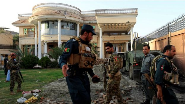 Afghan policemen inspect a midwife training centre after an attack in Jalalabad city, Afghanistan July 28, 2018