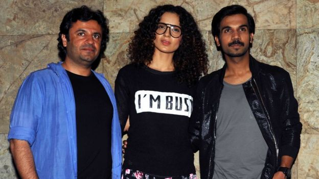Indian Bollywood personalities (L-R) Vikas Bahl, Kangana Ranaut and Rajkummar Rao attend a special screening for the upcoming Hindi film 'Queen' in Mumbai on February 28, 2014.