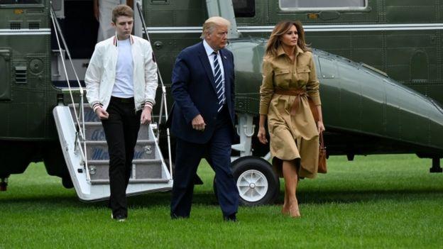 Barron Trump, Donald Trump and Melania Trump exit a helicopter