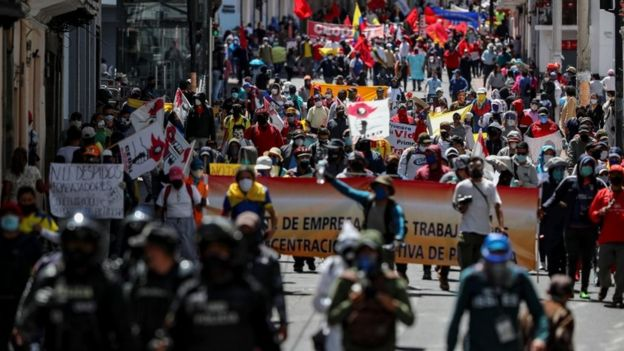 Protesters wearing face masks and carrying flags attended demonstrations organized by trade unions and social organisations, following cuts announced by President Lenín Moreno.
