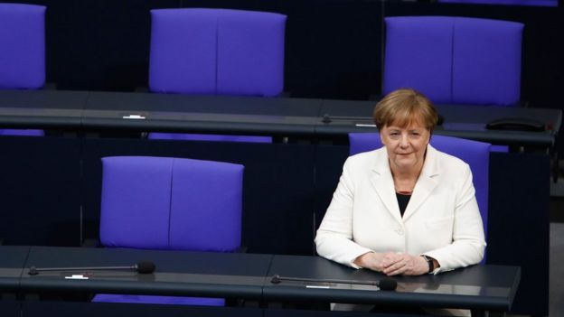 German Chancellor Angela Merkel sits on the government's bench after she took the oath during a swearing-in ceremony