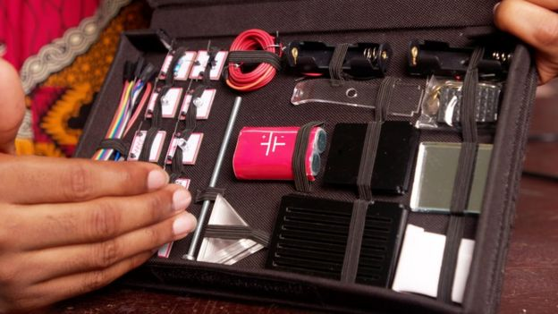 A box containing lots of science equipment including wires and batteries
