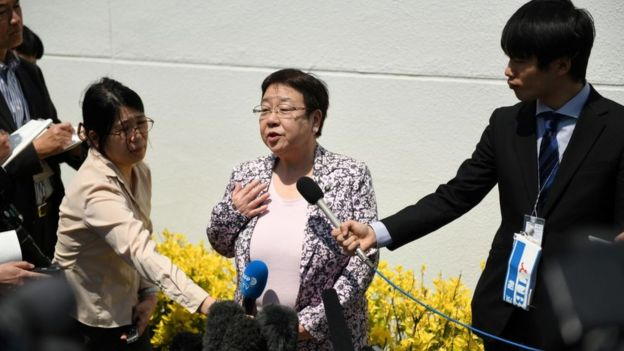 Mayor Tomoko Nakagawa speaks to reporters about her protest against the sumo policy