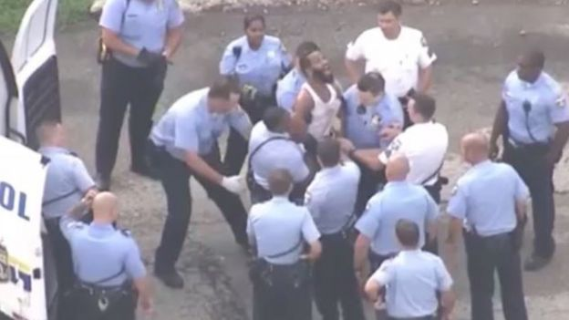 News helicopters filmed the suspect struggling with police