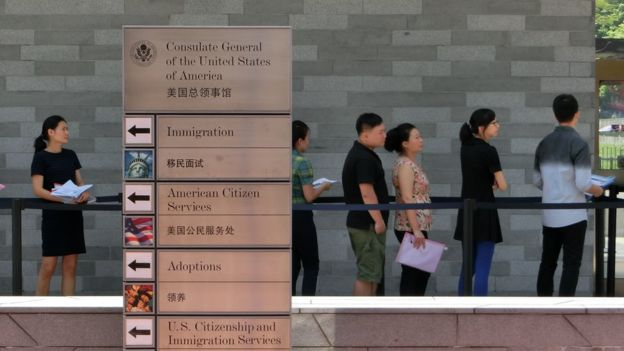 People apply for visas at the US consulate in Guangzhou, China