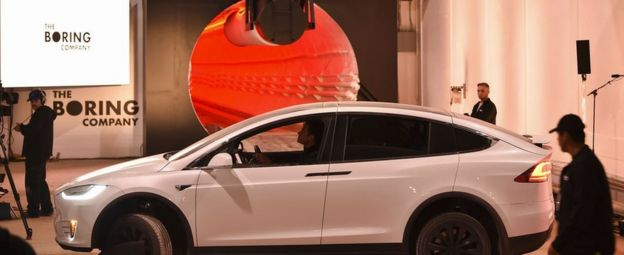 A modified Tesla Model X electric vehicle prepares to enter a tunnel during an unveiling event for The Boring Company Hawthorne test tunnel December 18, 2018
