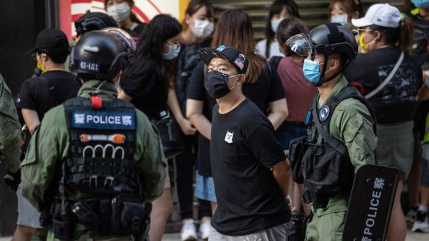 Hong Kong protests: Police tackle 12-year-old girl to the ground