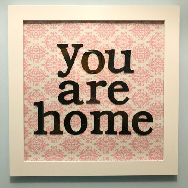 """A picture frame with the words """"you are home"""" in it"""