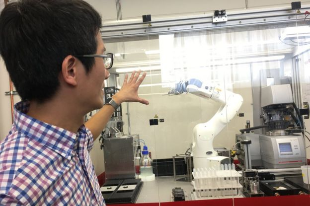 Chingyao Yang shows off one of Just Inc.'s robots