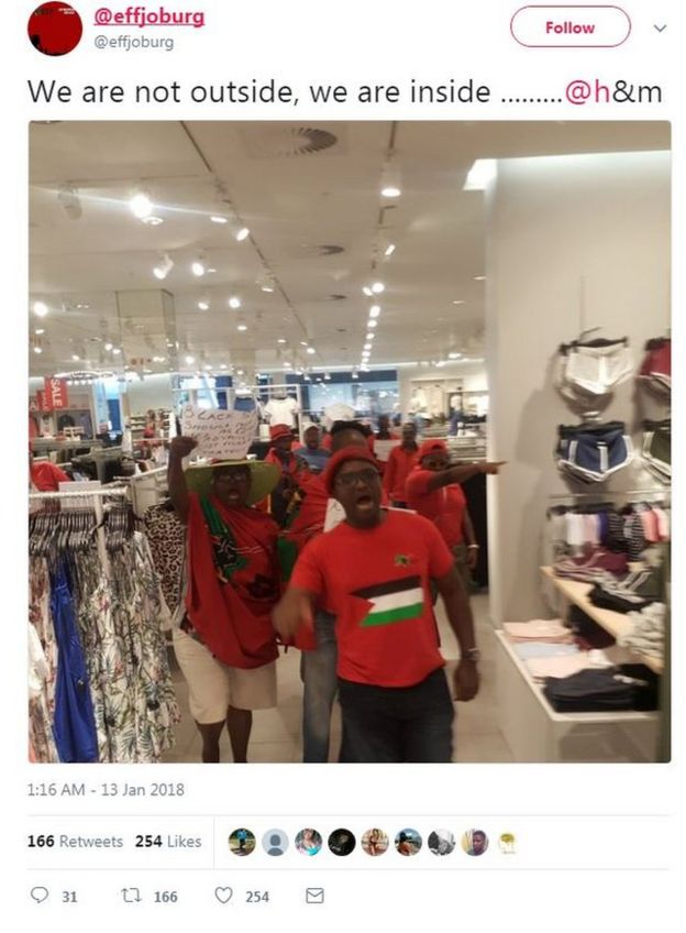 A tweet from the EFF in Johannesburg shows a picture of activists in red t-shirts protesting inside an H&M store