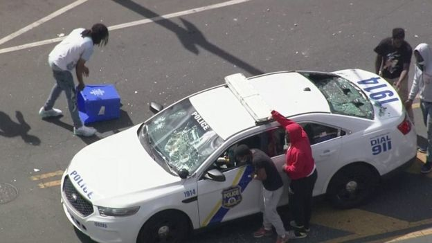 An attack on a police car in West Philadelphia on Sunday