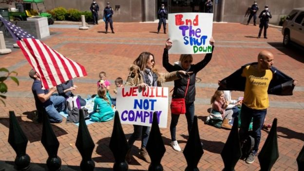 Protesters rally against stay-at-home orders related to the coronavirus pandemic outside Capitol Square in Richmond, Virginia on April 16, 2020