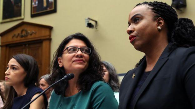 Alexandria Ocasio-Cortez (left), Rashida Tlaib (centre) and Ayanna Pressley (right)