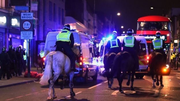 Riot police on horses