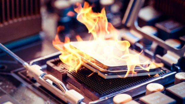 Computer chip in flames